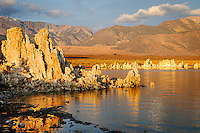 Early morning glow on the tufa formations of Mono Lake and Sierra peaks in the distance