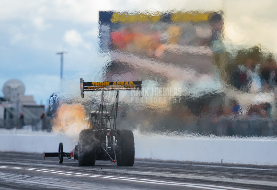 Feb 22, 2019; Chandler, AZ, USA; NHRA top fuel driver Brittany Force leaves heatwaves in her wake during qualifying for the Arizona Nationals at Wild Horse Pass Motorsports Park. Mandatory Credit: Mark J. Rebilas-USA TODAY Sports