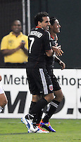D.C. United midfielder Andy Najar (14) celebrates with team mate Dwayne De Rosario his score. D.C. United defeated The Vancouver Whitecaps FC 4-0 at RFK Stadium, Saturday August 13 , 2011.
