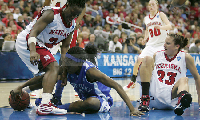 Senior guard Lydia Watkins fights for posession of the ball during the second half of the UK Women's Hoops win over No. 1 Nebraska on Sunday, March 28, 2010 at the Women's Sweet 16 Tournament in Kansas City, Mo. The Cats defeated the Huskers 76-67, sending the Cats to the Elite 8 for the first time in Kentucky history. Photo by Allie Garza | Staff