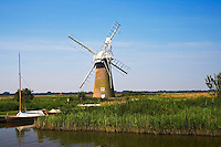 Windmill and moored sailing boats on the Norfolk Broads, United Kingdom RESERVED USE - NOT FOR DOWNLOAD -  FOR USE CONTACT TIM GRAHAM