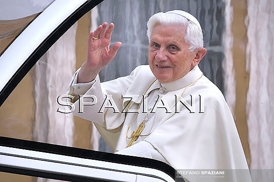 Pope Benedict XVI waves as he leaves his weekly general audience on  march 24, 2010 at St Peter's square at The Vatican.