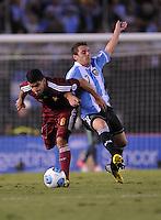 BUENOS AIRES, ARGENTINA, 22 MARÇO 2013 - COPA 2014 - ELIMINATORIAS SUL-AMERICANA - ARGENTINA X VENEZUELA - Montillo (D) jogador da Argentina durante partida contra a Venezuela em partida pela 11 rodada das eliminatórias sul-americana para a Copa do Mundo de 2014 no Estádio Monumental de Núñes em Buenos Aires capital da Argentina, na noite desta sexta-feira, 22. (FOTO: JUANI RONCORONI / BRAZIL PHOTO PRESS).