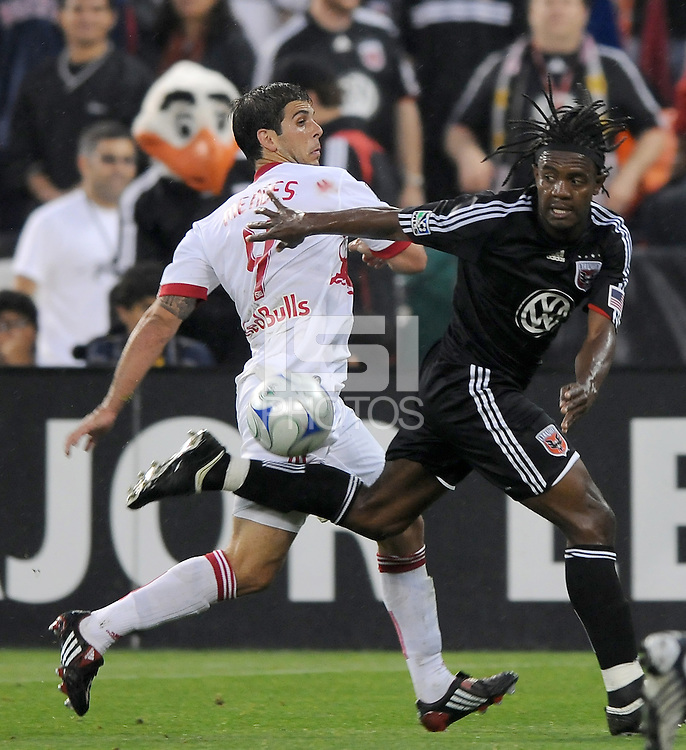 DC United forward Luciano Emilio (11) fights to keep possession of the ball against New York Red Bulls defender Carlos Mendes (4)   DC United defeated the New York Red Bulls 2-0, at RFK Stadium ,Thursday June 4, 2009.