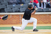 Joey Rodriguez (7) of the Wake Forest Demon Deacons attempts to lay down a bunt against the Florida State Seminoles at Wake Forest Baseball Park on April 19, 2014 in Winston-Salem, North Carolina.  The Seminoles defeated the Demon Deacons 4-3 in 13 innings.  (Brian Westerholt/Four Seam Images)