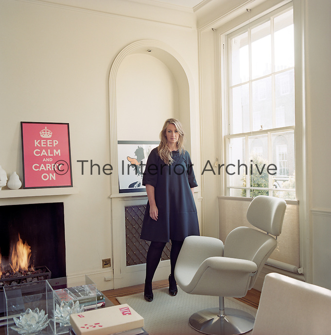 Anya Hindmarch standing in the living room of her London home
