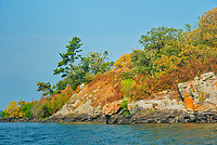 Orange lichens on rock on Island in Lake of the Woods<br />Kenora District<br />Ontario<br />Canada