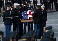 A military casket team carries casket of former President George. H. W. Bush to the Capitol Rotunda in Washington, DC where he will lie state, December 3, 2018. <br /> CAP/MPI/RS<br /> &copy;RS/MPI/Capital Pictures