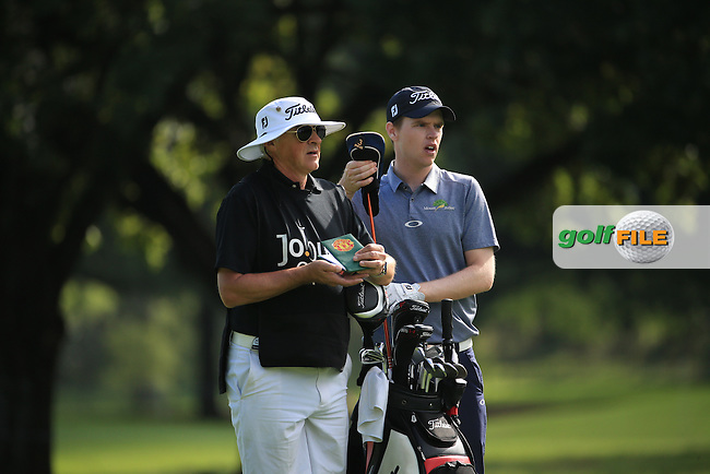 Kevin Phelan (IRL) and caddie Gerry Byrne prepare for second shot to the 8th during the Final Round of the 2016 Joburg Open Celebrating 10 years, played on the East Course at the Royal Johannesburg and Kensington Golf Club, Gauteng, Johannesburg, South Africa.  17/01/2016. Picture: Golffile | David Lloyd<br /> <br /> All photos usage must carry mandatory copyright credit (&copy; Golffile | David Lloyd)