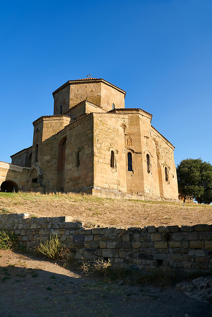 Pictures & images of Jvari Monastery, a 6th century Georgian Orthodox monastery near Mtskheta, eastern Georgia. A UNESCO World Heritage Site.<br /> <br /> The Jvari church is an early example of a four apse church with four niches domed tetraconch. The Jvari church had a great impact on the further development of Georgian architecture and served as a model for many other churches.<br /> <br /> The Historical Monuments of Jvari Monastery Mtskheta is located in the cultural landscape overlooking the confluence of the Aragvi and Mtkvari Rivers, in Central-Eastern Georgia, some 20km northwest of Tbilisi.