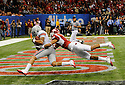 .Ohio State University wide receiver DeVier Posey scores during the second quarter of the Allstate Sugar Bowl in New Orleans, Louisiana January, 4, 201. The Ohio State Buckeyes defeated the Arkansas Razorbacks, 31- 26.....(Cheryl Gerber/AP Images for Allstate)