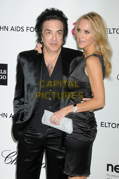 Paul Stanley & Erin Sutton.20th Annual Elton John Academy Awards Viewing Party held at West Hollywood Park, West Hollywood, California, USA..February 26th, 2012.half length black suit dress silver clutch bag married husband wife .CAP/ADM/BP.©Byron Purvis/AdMedia/Capital Pictures.