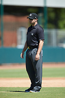 Umpire Colin Baron handles the calls on the bases during the South Atlantic League game between the Charleston RiverDogs and the Hickory Crawdads at L.P. Frans Stadium on May 13, 2019 in Hickory, North Carolina. The Crawdads defeated the RiverDogs 7-5. (Brian Westerholt/Four Seam Images)