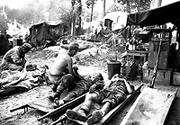 American medics treat casualties at an American portable surgical unit during the 36th Division drive on Pinwe, Burma.  November 12, 1944.  Sgt. W. Lentz.  (Army)<br /> NARA FILE #:  111-SC-198263<br /> WAR & CONFLICT BOOK #:  917