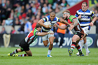 Jonathan Joseph of Bath Rugby is tackled by Joe Marler (right) and Nick Evans of Harlequins during the Aviva Premiership match between Harlequins and Bath Rugby at The Twickenham Stoop on Saturday 10th May 2014 (Photo by Rob Munro)