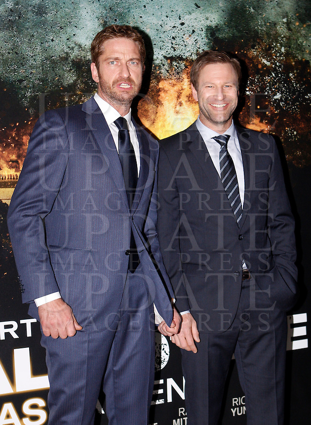 "L'attore scozzese Gerard Butler, sinistra, e lo statunitense Aaron Eckhart all'anteprima del film ""Attacco al potere"" a Roma, 5 aprile 2013..Actors Gerard Butler, of Britain, left, and  Aaron Eckhartm of the United States, pose at the premiere of the movie ""Olympus has fallen"" in Rome, 5 April 2013..UPDATE IMAGES PRESS/Riccardo De Luca"