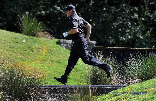 NORTH PLAINS, OR - AUGUST 21: Alex Cejka of Germany runs across a footbridge on the fourth hole during the first round of the WinCo Foods Portland Open presented by Kraft on August 21, 2014 in North Plains, Oregon.  (Photo by Steve Dykes/Getty Images) *** Local Caption *** Alex Cejka