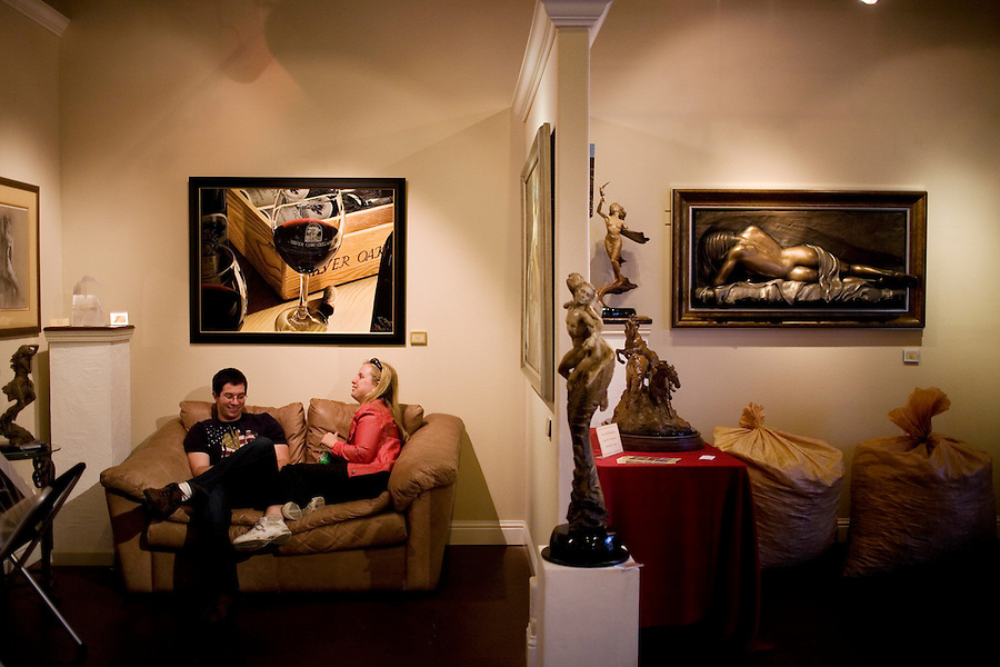 "NAMES SQ: John Park Jennings and Katrina Redelsheimer, of San Francisco, hang out the Quent Cordair Fine Art, on First Street, in Napa, Ca., on Saturday, May 22, 2010. The 14-year-old romantic realism gallery moved from south of the City to Napa two years ago. Owner Linda Cordair coined the term ""West End"" to help revitalize downtown Napa. Recent development along First Street includes a new boutique hotel, Avia Napa, at right, two new restaurants across the street, and tasting rooms has helped revitalize Napa's downtown, which has recently been coined the ""West End."""