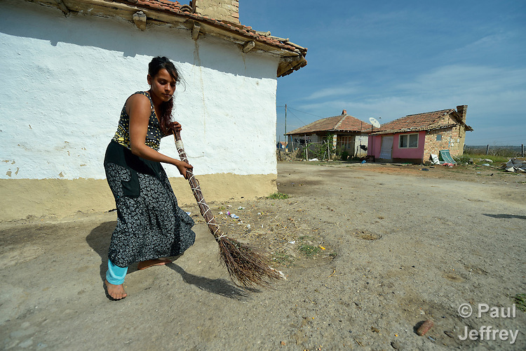 Pepa Adre, 25, sweeps the ground around her home in a largely Roma, Turkish-speaking neighborhood of Dobrich, in the northeast of Bulgaria.