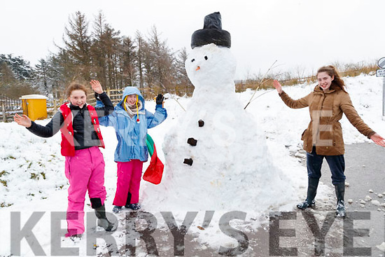 April, Kely and Casey Mahony with their snowman in Kilflynn on Friday.