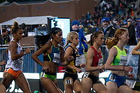 Mizzou junior Karissa Schweizer runs between two of the four Olympians (Brenda Martinez and Shelby Houlihan) in the professional women's 1500-meters and just ahead of the only other collegian (Kaela Edwards) in the field on her way to an 8th-place finish in the 15 runner race at the Drake Relays, Friday, April 28, in Des Moines, Iowa. Scheizer finished in 4:18.16 on a cool night.