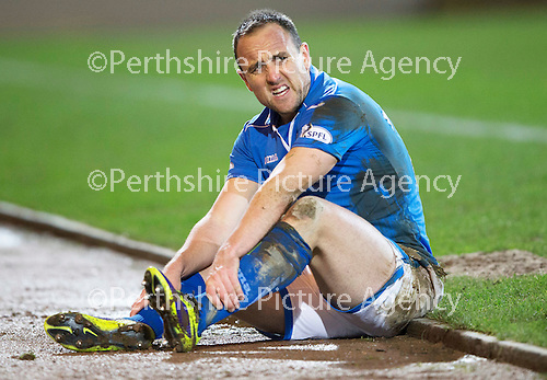St Johnstone v Motherwell....25.02.14    SPFL<br /> Lee Croft gets a sore one after being taken out by James McFadden<br /> Picture by Graeme Hart.<br /> Copyright Perthshire Picture Agency<br /> Tel: 01738 623350  Mobile: 07990 594431