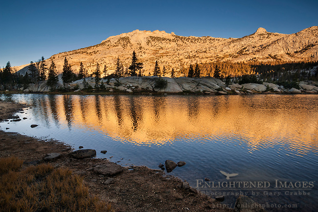 Morning light on mountain reflected in Boothe Lake, Vogelsang region, Yosemite National Park, California