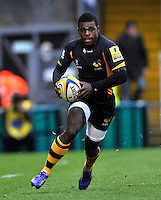 High Wycombe, England. Christian Wade of London Wasps in action during the Aviva Premiership match between London Wasps and Sale Sharks at Adams Park on December 23. 2012 in High Wycombe, England.
