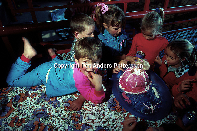 White children having a birthday party at a Steers hamburger restaurant in on June 18, 2001 in Vryburg, South Africa. Vryburg, a small and very conservative farming town about 400 km west of Johannesburg has had a lot of high profile racist attacks since the democratic elections in 1994. A black boy is currently in prison after stabbing a white boy in Vryburg High School.The school has had a problem with  the integration of the black pupils in the former only white school. Some bars and restaurants are still for whites only. South Africa is still battling racism and after seven years of a democraticly elected black government..(Photo: Per-Anders Pettersson)