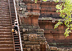 The Way Up - Tourist climbing the steep steps up Phimeanakas Temple, Angkor Thom, Cambodia