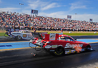 Sept. 24, 2011; Ennis, TX, USA: NHRA funny car driver Cruz Pedregon (near lane) races alongside Johnny Gray during qualifying for the Fall Nationals at the Texas Motorplex. Mandatory Credit: Mark J. Rebilas-