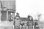 Joyce family children posing at Antonito water tank.<br /> D&amp;RG  Antonito, CO  Taken by Joyce, W. D. - 1917
