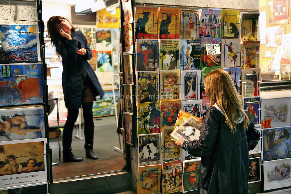 A girl looks at art posters for sale outside a shop in Montmartre, Paris, France, 17 September 2009