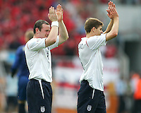 Wayne Rooney and Steven Gerrard of England salute the England fans after the game. England defeated Trinidad & Tobago 2-0 in their FIFA World Cup group B match at Franken-Stadion, Nuremberg, Germany, June 15 2006.