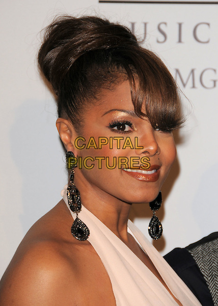 JANET JACKSON.The 2008 Clive Davis Pre-Grammy Party held at The Beverly Hilton Hotel in Beverly Hills, California on .February 9th, 2008          .headshot portrait white cream halterneck top black dangling earrings .CAP/DVS.©Debbie VanStory/Capital Pictures.