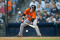 Mike Yastrzemski (4) of the Bowie Baysox lays down a bunt against the Richmond Flying Squirrels at The Diamond on May 23, 2015 in Richmond, Virginia.  The Baysox defeated the Flying Squirrels 3-2.  (Brian Westerholt/Four Seam Images)