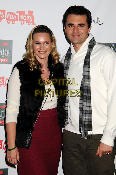 Natasha Henstridge & Darius Campbell (Danesh).2012 Hollywood Christmas Parade held on Hollywood Blvd., Hollywood, California, USA.  .November 25th, 2012.half length married husband wife  top scarf jeans denim white red skirt gilet brown black.CAP/ADM/BP.©Byron Purvis/AdMedia/Capital Pictures.