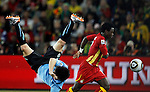 Uruguay`s Jorge Fucile is tackled by Samuel Inkoom from Ghana, Soccer, Football - 2010 FIFA World Cup - Johannesburg, South Africa, Friday, July, 02,  2010. Uruguay vs Ghana, Round of 8, Quarter-finals, Soccer City Stadium (credit & photo: Pedja Milosavljevic / +381 64 1260 959 / thepedja@gmail.com / STARSPORT )