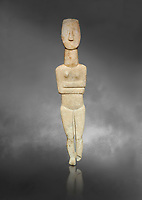 Marble female Cycladic statue figurine with folded arms of the Spedos type. Early Cycladic Period II (2800-3200) from Naxos, Cat No 20934. National Archaeological Museum, Athens.   Gray background.<br /> <br /> <br /> One of the largest known Cycladic statues at 89CM tall this figurine still has traces of a colour on the hair and eyes.