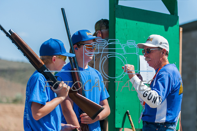 Jonh Luckie, coach for Mother Lode Gun Club, gives advice to Riley Strickland,14,left, and Tristan Hagstrom,14, during the California Youth Shotgun Shooting Association&rsquo;s championship shootout at the Capitol City Gun Club in Carson City, Nev. on Saturday, May 2, 2015.<br /> Photo by Kevin Clifford/Nevada Photo Source