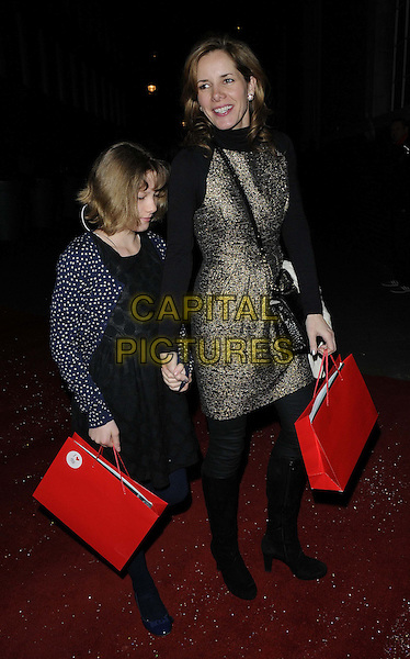 Darcey Bussell & her daughter.The English National Ballet - Nutcracker gala performance, London Coliseum, St Martin's Lane, London, England..December 13th, 2012.full length  red goody bag gold dress holding hands blue mother mom mum kid child family .CAP/CAN.©Can Nguyen/Capital Pictures.