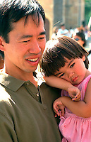 Father holding daughter at Asian American Festival ages 36 and 2.  St Paul Minnesota USA