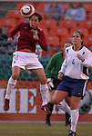 16 October 2004, Cat Reddick (4) of the U.S. Women's National Team looks on as Teresa Worbis (11) of Mexico wins a header as the USA defeats Mexico 1-0 at Arrowhead Stadium, Kansas City, Missouri..