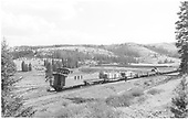 Long D&amp;RGW eastbound freight departing Cumbres, stretched out on Tanglefoot curve, from back and above.<br /> D&amp;RGW  Cumbres, CO  Taken by Richardson, Robert W. - 1956