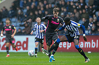 Leeds United's Patrick Bamford competing with Sheffield Wednesday's Dominic Iorfa (right) <br /> <br /> Photographer Andrew Kearns/CameraSport<br /> <br /> The EFL Sky Bet Championship - Sheffield Wednesday v Leeds United - Saturday 26th October 2019 - Hillsborough - Sheffield<br /> <br /> World Copyright © 2019 CameraSport. All rights reserved. 43 Linden Ave. Countesthorpe. Leicester. England. LE8 5PG - Tel: +44 (0) 116 277 4147 - admin@camerasport.com - www.camerasport.com