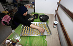A Palestinian woman prepares traditional cookies ahead of the Eid al-Fitr festivities, celebrating the end of the holy Muslim fasting month of Ramadan, in Gaza city on May 30, 2019. Photo by Mahmoud Ajjour