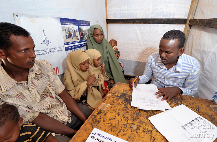 A newly arrived Somali refugee family is interviewed by a worker for the ACT Alliance during the registration process for new refugees in the Dadaab refugee camp in northeastern Kenya. Tens of thousands of newly arrived Somalis who have swelled the population of what was already the world's largest refugee camp. The ACT Alliance, through the Lutheran World Federation, is camp manager.