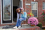 "Karen Morris has been caring for her mother Gloria, 80, for the past 10 years. Her mother has Alzheimer's disease and lives with Karen and Karen's husband Richard in their Charlotte, NC home. The pair take in the morning sunshine on the front porch and Karen embraces her mother and hopes to see what is wrong...Mrs. Morris was a nurse before she retired and really enjoys taking care of people, she said. Every morning she washes her mother in the bathroom, helps her walk down the stairs, and they share breakfast, as they did Monday, October 18, 2010...Gloria was having an especially bad day and because Karen sees her every day, she knew something was wrong. She later discovered her medication was dehydrating her. That is one of many reasons why having a regular caretaker is so important. ..Released: Yes.""Caretaker"".Assignment c/o Ilene Bellovin"