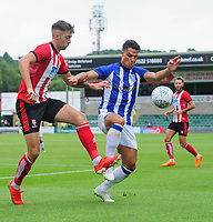 Lincoln City's Ellis Chapman vies for possession with Sheffield Wednesday's Joey Pelupessy<br /> <br /> Photographer Chris Vaughan/CameraSport<br /> <br /> Football Pre-Season Friendly - Lincoln City v Sheffield Wednesday - Saturday July 13th 2019 - Sincil Bank - Lincoln<br /> <br /> World Copyright © 2019 CameraSport. All rights reserved. 43 Linden Ave. Countesthorpe. Leicester. England. LE8 5PG - Tel: +44 (0) 116 277 4147 - admin@camerasport.com - www.camerasport.com