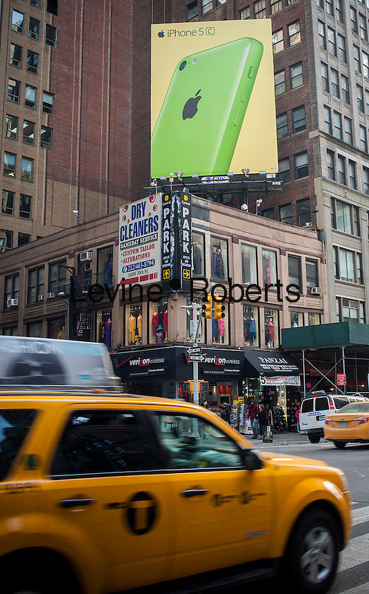 A billboard advertising the Apple iPhone 5C in Midtown Manhattan in New York on Saturday, February 1, 2014.   (© Richard B. Levine)